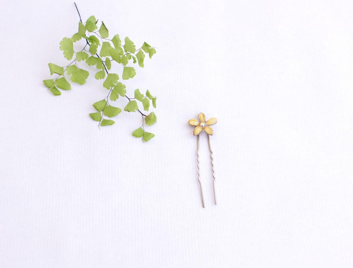 pincho moño flor